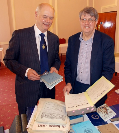 Tony Baker (left) making additions to his masonic library with Roy Chapman